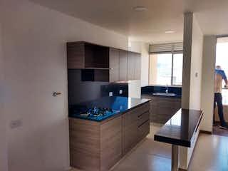 Una cocina con un fregadero y una estufa en venta Apartamento Sabaneta, Antioquia