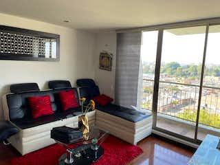 Una sala de estar llena de muebles y una televisión de pantalla plana en VENTA DE APARTAMENTO MODELIA (FONTIBON)