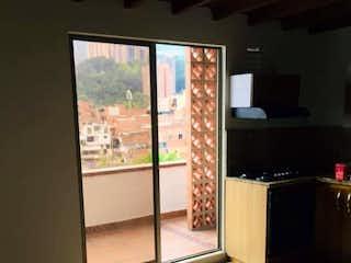 Una vista de una habitación con una puerta de cristal en Apartamento en venta en San Jose La Estatua, Envigado.