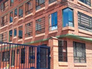 Un edificio de ladrillo con un edificio de ladrillo rojo en Apartamento En Venta En La Calera La Calera