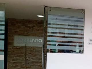 Un banco de madera delante de un edificio en Apartamento En Arriendo/venta En Bogota San Cristobal Norte-Usaquén