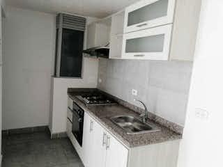 Una cocina con una estufa y un fregadero en OPORTUNIDAD SE VENDE HERMOSO APARTAMENTO EN ZIPAQUIR EXCELENTE UBICAC