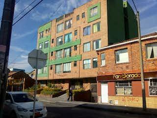Una señal de calle en una esquina de la calle en Apartamento en Venta ALFONSO LOPEZ