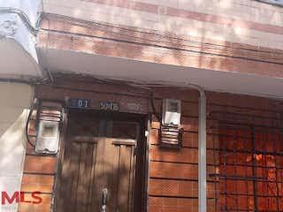 Un parquímetro delante de un edificio en No aplica