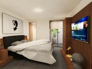 Un dormitorio con una cama y una televisión de pantalla plana en Guadalquivir 73