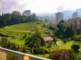 Una vista de una ciudad con árboles en el fondo en APARTAMENTO EN ENVIGADO PARA ESTRENAR