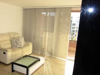 Una sala de estar llena de muebles y una ventana en EDIFICIO SINALOA