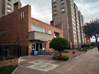 Un gran edificio de ladrillo con una torre de reloj en Apartamento En Venta En Bogota El Recodo