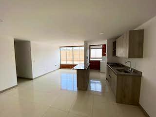 Una cocina con un fregadero y una estufa en Apartamento en La Ceja