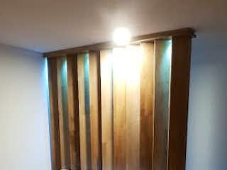Una sala de estar llena de muebles y un suelo de madera en Apartamento en venta en Pan de Azúcar, de 74mtrs2
