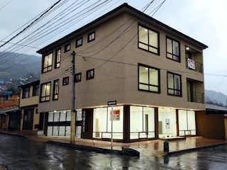 Un gran edificio con un reloj en el costado en Apartamento en venta en Casco Urbano Tenjo 87m²