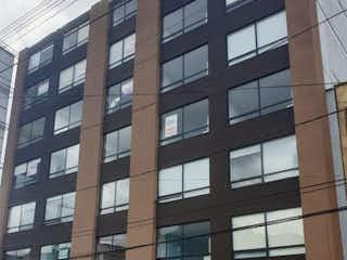 Un edificio alto sentado al lado de una calle en VENDO APARTAESTUDIO ESTRENAR SAN LUIS (TEUSAQUILLO)