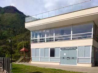 Una foto de una casa en la hierba en Apartamento Con Parqueadero En Mirador Bello - Antioquia