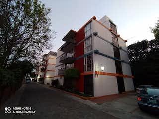 Un edificio alto con un reloj en la parte superior en Departamento (Penthouse) en Venta, en La Magdalena Contreras , Ciudad de México