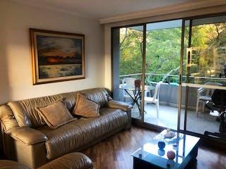 Una sala de estar llena de muebles y una gran ventana en 103529 - Vendo Apartamento Poblado Medellin Colombia