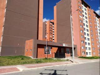 Un edificio de ladrillo alto con una torre de reloj en Venta Apartamento Zipaquira San Rafael