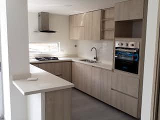 Una cocina con nevera y fregadero en Apartamento en venta en Velódromo de 2 habitaciones