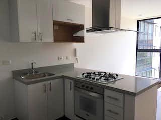 Una cocina con una estufa y un fregadero en Apartaestudio En Arriendo/venta En Bogota Cedritos-Usaquén