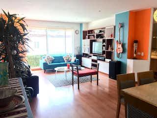 Una sala de estar llena de muebles y una televisión de pantalla plana en Apartamento En Venta En Bogota Lisboa-Usaquén
