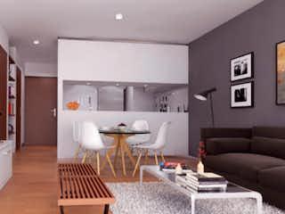 Una sala de estar llena de muebles y una televisión de pantalla plana en Etre