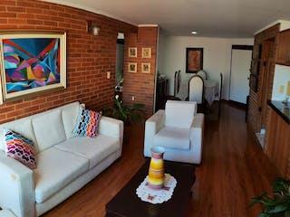 Una sala de estar llena de muebles y una televisión de pantalla plana en Apartamento en Venta LA VICTORIA NORTE