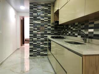 Una cocina con un fregadero y un horno de cocina en SE VENDE CASA CON APARTAESTUDIO EN ITAGUI, VILLA PAULA