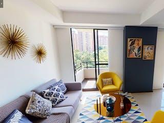 Una sala de estar llena de muebles y una gran ventana en Ventum