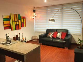Una sala de estar llena de muebles y una gran ventana en Apartaestudio En Venta En Bogota Chapinero Norte
