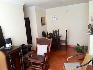 Una sala de estar llena de muebles y una televisión de pantalla plana en APARTAMENTO UNIDAD POBLADO DE VERACRUZ