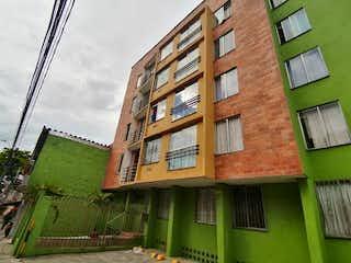 Un edificio de ladrillo alto con una ventana grande en Apartamento en Venta BUENOS AIRES