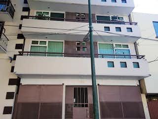 Un gran edificio con un reloj en él en Venta Departamento - Benito Juárez