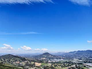 Una vista de una montaña en un cielo azul en Venta Lotes Vista Panoramica sector tranquilo