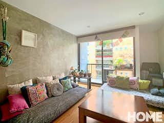 Una sala de estar llena de muebles y una ventana en MODERNO APARTAMENTO DE 2 HABS – VENTA – Cll87 Cra19b – LA CASA EN EL ARBOL -VIRREY