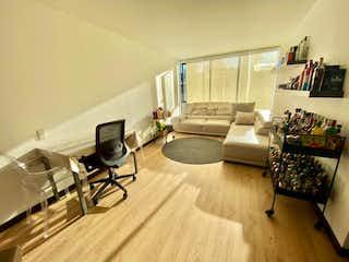 Una sala de estar llena de muebles y una televisión de pantalla plana en ZS-909 Apartamento en Venta, Chico Navarra