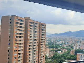 Una vista del horizonte de la ciudad desde una ventana en Apartamento en venta en San Germán con Piscina...