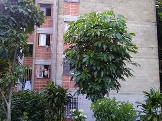 Una palmera delante de una casa en Apartamento en Venta TRICENTENARIO