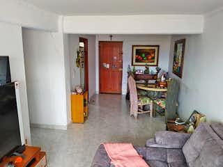 Una sala de estar llena de muebles y una chimenea en Apartamento en venta en Universidad Medellín, 78mt con balcon