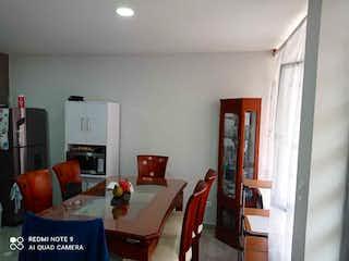 Una sala de estar llena de muebles y una televisión de pantalla plana en Se vende casa en zipaquira villas del rosario opción de tres niveles.