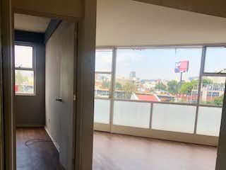 Una vista de una habitación con una puerta de cristal en Departamento en Venta / Av. Patriotismo