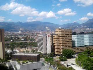 Una vista de una ciudad con un horizonte de la ciudad en el fondo en Venta/ Apartamento/ Ciudad del Rio/ Medellín