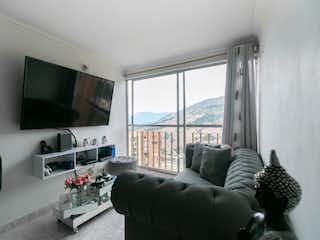 Una sala de estar llena de muebles y una televisión de pantalla plana en Apartamento en venta en Bomboná No. 2, de 53mtrs2