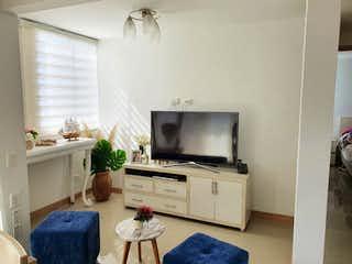 Una sala de estar llena de muebles y una televisión de pantalla plana en Apartamento en venta en Pan de Azúcar, de 66mtrs2