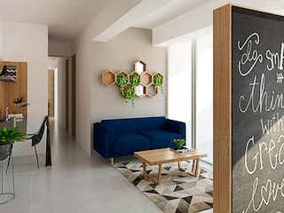 Una sala de estar llena de muebles y una ventana en Terraverde - Ocre