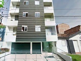 Un edificio con un reloj en el costado en Apartamento en Venta LOS ALPES