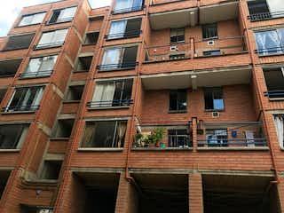 Un gran edificio de ladrillo con una gran ventana en 103858 - Venta Apartamento La Frontera Envigado