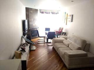 Una sala de estar llena de muebles y una televisión de pantalla plana en Bogotá, Venta Apartaestudio, Santa Barbara Occidental