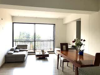 Una sala de estar llena de muebles y una gran ventana en Apartamento En Venta En Bogota Barrancas