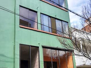 Un edificio verde con un edificio verde y blanco en Apartamento en Venta BOSTON