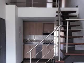 Una foto en blanco y negro de una cocina en Se Vende Apartamento  Duplex en Laureles ,Medellin