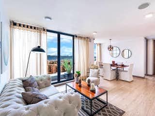 Una sala de estar llena de muebles y una gran ventana en Urban Salitre - Zurich